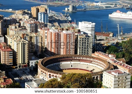 Elevated view of the bullring and port area, Malaga, Costa del Sol, Malaga Province, Andalusia, Spain, Western Europe. - stock photo