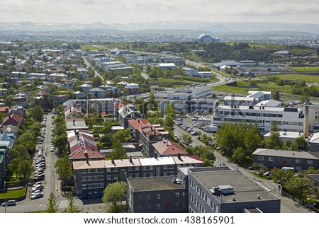Elevated view of the South of Reykjavik with the Perlan building in the background - stock photo