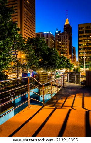 Elevated walkway and buildings at night in Baltimore, Maryland.