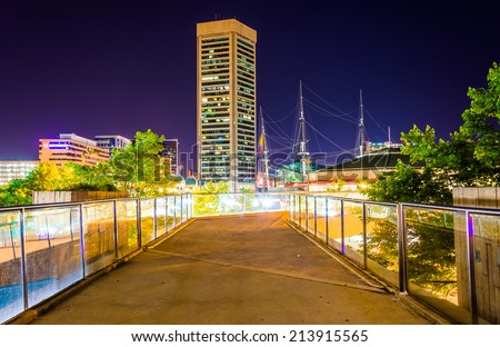 Elevated walkway and the World Trade Center at night in Baltimore, Maryland. - stock photo