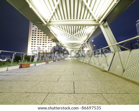 Elevated walkway in night - stock photo