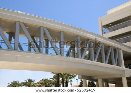 Elevated walkway into hospital from parking garage - stock photo