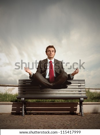 Elevation of a businessman in relax - stock photo