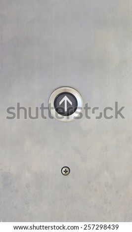 Elevator Button up direction on stanless plate - stock photo