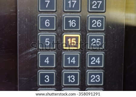 Elevator button with number 15 pushed