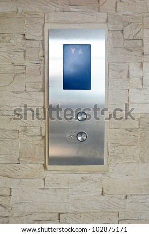 Elevator buttons on sandstone - stock photo