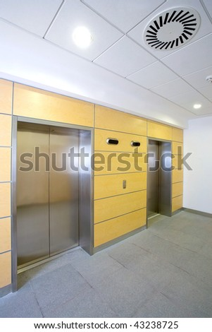 Elevator entrance in modern office building - stock photo