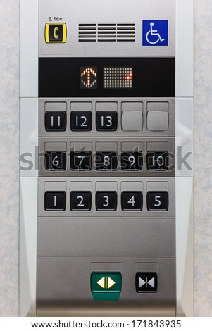 Elevator panel with push buttons for normal people and hadicapped person - stock photo