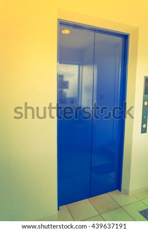 Elevator with closed door  ( Filtered image processed vintage effect. ) - stock photo