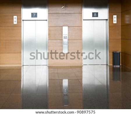 Elevator with two silver door - stock photo