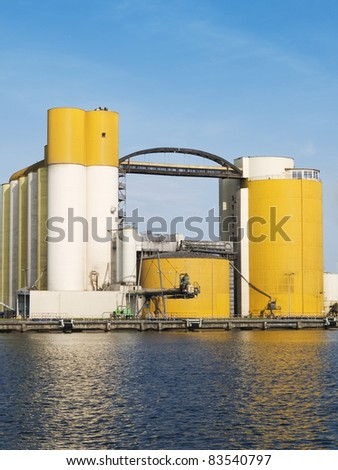 Elevators for malt and grain located beside port canal - stock photo