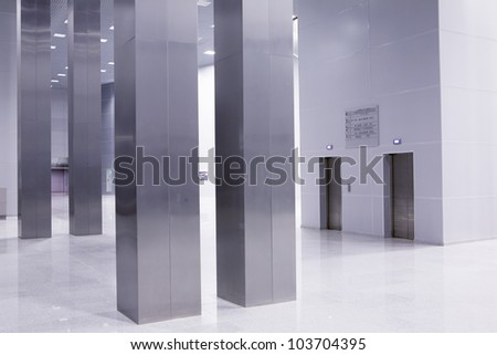 Elevators in hall of  modern business building - stock photo
