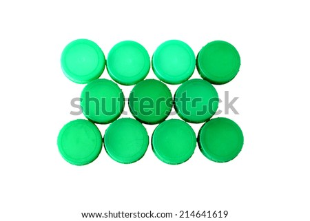 Eleven Green plastic milk bottle tops in neat rows on white background - stock photo