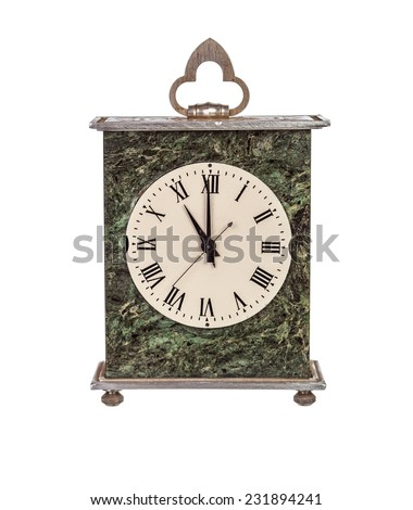Eleven o'clock on isolated mantel clock on white background