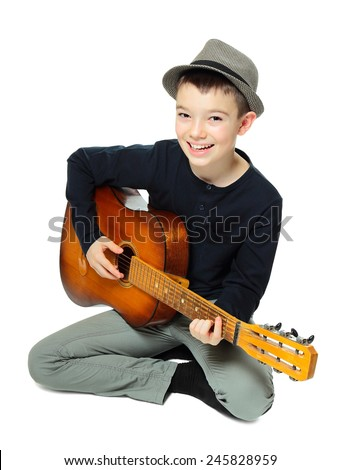 Eleven years old boy playing guitar on white background  - stock photo