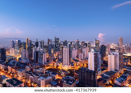 Eleveted, night view of Makati, the business district of Metro Manila.  - stock photo