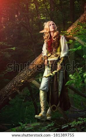 Elf holding a bow with an arrow - stock photo