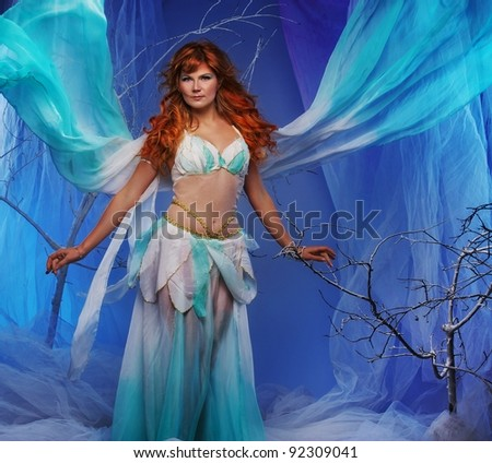 Elf in magical winter forest. - stock photo