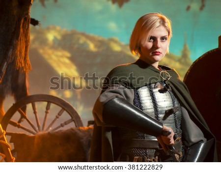 elf princess with sword in metal armor - stock photo