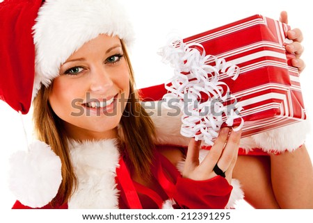 Elf: Santa Girl Holds Up Wrapped Christmas Present - stock photo