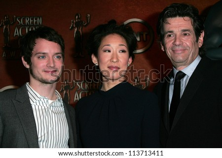 Elijah Wood with Sandra Oh and Alan Rosenberg at the press conference announcing the nominations for the 13th Annual Screen Actors Guild Awards. Pacific Design Center, West Hollywood, CA. 01-04-07