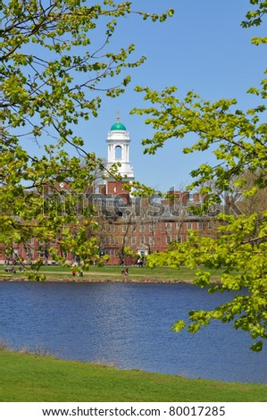 Eliot House, Harvard University, across Charles River. White tower and green dome framed by spring leaves. - stock photo