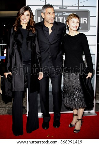 """Elisabetta Canalis, George Clooney and his mother Nina at the Los Angeles Premiere of """"Up In The Air"""" held at the Mann Village Theater in Westwood, California, United States on November 30, 2009.  - stock photo"""