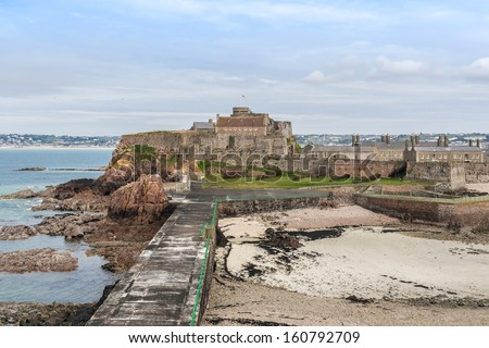 Elizabeth Castle (1594) - castle and tourist attraction on a tidal island within parish of Saint Helier, Jersey, UK.