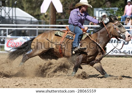 ELIZABETH, CO- JUNE 7: World Champion Barrel Racer Brittany Pozzi-Pharr competes in the Elizabeth Stampede June 7, 2008 in Elizabeth. It is considered one of the best small town rodeos in the country. - stock photo