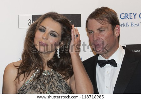 Elizabeth Hurley and Shane Warne arriving for the Grey Goose Ball 2012, Battersea Power Station, London. 10/11/2012 Picture by: Simon Burchell - stock photo
