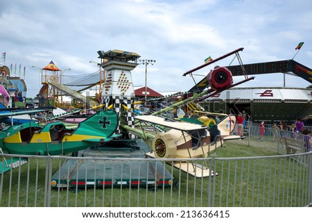 ELIZABETHTOWN, PA, USA-AUGUST 20, 2014:  Carnivals and country fairs are in full swing. They are common in late summer and early fall and include exhibits, food, rides, and entertainment for all ages. - stock photo