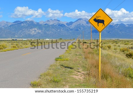 Elk/Deer Sign along Road - stock photo