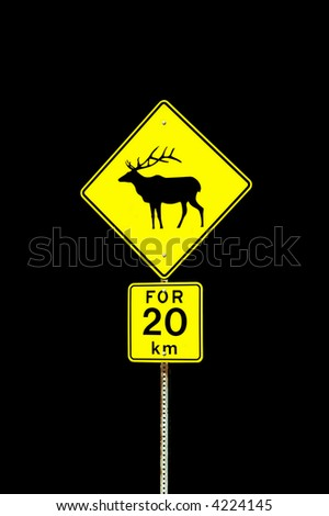Elk road sign warning travellers to watch for elk crossing the highway - stock photo