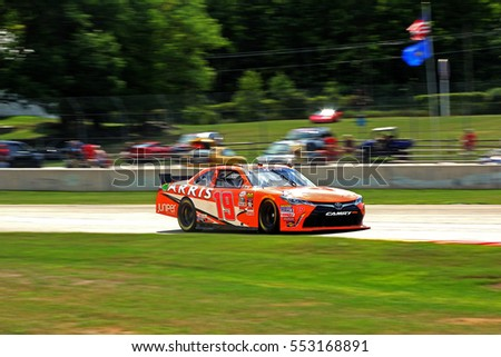 Elkhart Lake Wisconsin USA - August 26, 2016: NASCAR Xfinity racing series. Road America 180 Fired Up by Johnsonville. 19 Daniel Suarez Juniper Networks Toyota Camry, enters corner. Joe Gibbs Racing