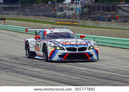 Elkhart Lake, Wisconsin USA - August 9, 2015: Road America road course, IMSA. BMW Team RLL, IHG Rewards Club, BMW Z4 GTE races down pit lane to re-join the race - stock photo