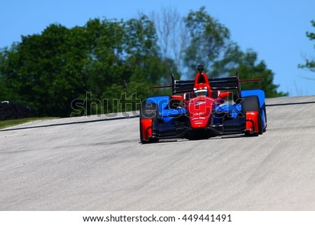 Elkhart Lake Wisconsin USA - 24 June 2016: Indycar racing action Road America. Practice session: Mikhail Aleshin #7, Schmidt Peterson Motorsports, SMP Racing