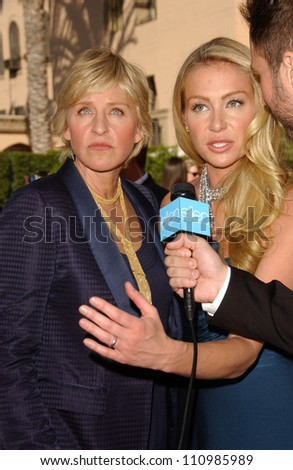 Ellen DeGeneres and Portia de Rossi arriving at the 59th Annual Primetime Emmy Awards. The Shrine Auditorium, Los Angeles, CA. 09-16-07 - stock photo