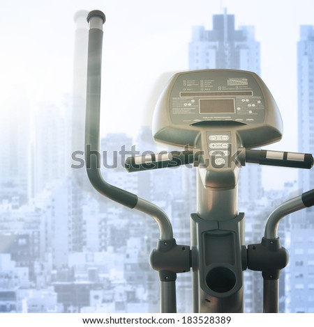 elliptical cross trainer in a row in a gym - stock photo