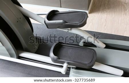 elliptical cross trainer in sport gym - stock photo