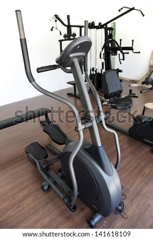 Elliptical cross trainer on fitness room - stock photo