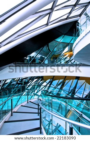 Elliptical downstairs way in glass office building - stock photo