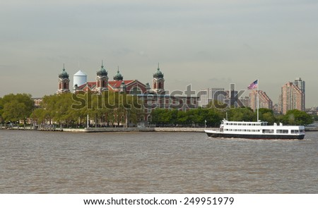 Ellis Island in and transportation ship New York harbour - stock photo