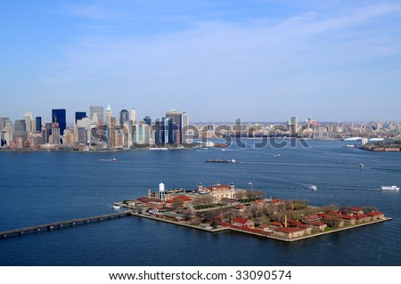 Ellis Island in New York City was the main entry point of immigrants to the United States in 1892-1954, nowadays a museum. Behind left is Manhattan. - stock photo