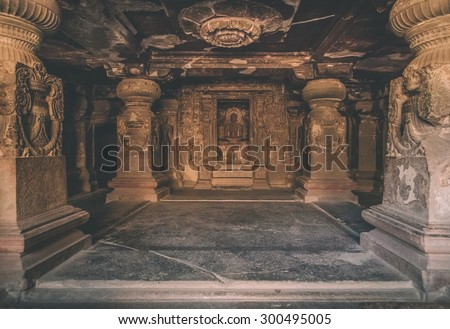 ELLORA, INDIA - 14 JANUARY 2015: Ellora Caves is an archaeological site close to city of Aurangabad. Ellora is a World Heritage Site. Processed with grain, texture and color effect. - stock photo