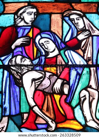 ELLWANGEN, GERMANY - MAY 07: Pieta, stained glass window in Basilica of St. Vitus in Ellwangen, Germany on May 07, 2014. - stock photo
