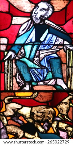 ELLWANGEN, GERMANY - MAY 07: The Prophet Micah with a lion symbol, stained glass window in Basilica of St. Vitus in Ellwangen, Germany on May 07, 2014. - stock photo