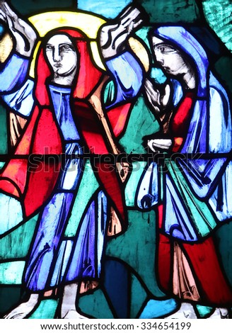 ELLWANGEN, GERMANY - MAY 07: Visitation of Mary to Elizabeth, Stained glass window in Basilica of St. Vitus in Ellwangen, Germany on May 07, 2014. - stock photo