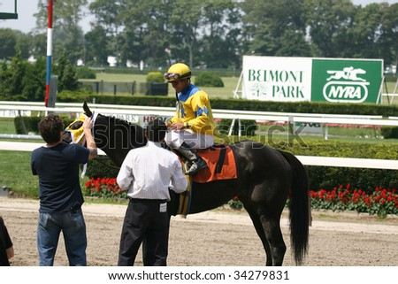 ELMONT, NY- JULY 25: Javier Castellano aboard Four Star General at the Winners Circle after the forth race at Belmont Park- July 25, 2009 in Elmont, NY.