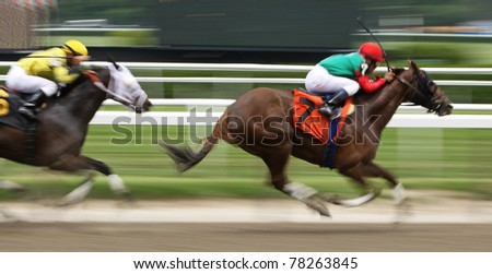 ELMONT, NY - MAY 29: Cornelio Velasquez and Full of Gut storm by Javier Castellano and Lady of the Forest to win a claiming race at Belmont Park on May 29, 2011 in Elmont, NY. - stock photo