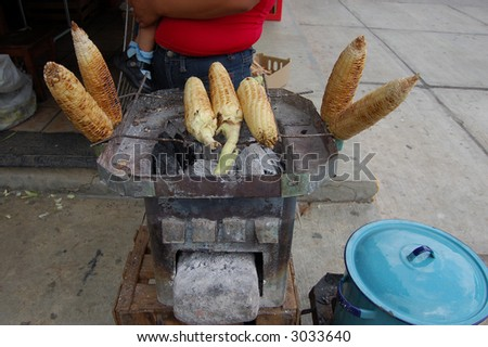 Elote cooked on a street corner in Chiapas, Mexico - stock photo